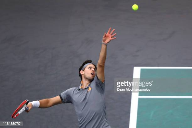 Dominic Thiem of Austria serves against Milos Raonic of Canada on day 3 of the Rolex Paris Masters, part of the ATP World Tour Masters 1000 held at...
