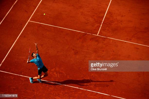 Dominic Thiem of Austria serves during his mens singles first round match against Tommy Paul of The United States during Day two of the 2019 French...