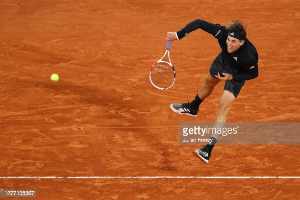 Dominic Thiem of Austria serves during his Men's Singles first round match against Marin Cilic of Croatia on day two of the 2020 French Open at...
