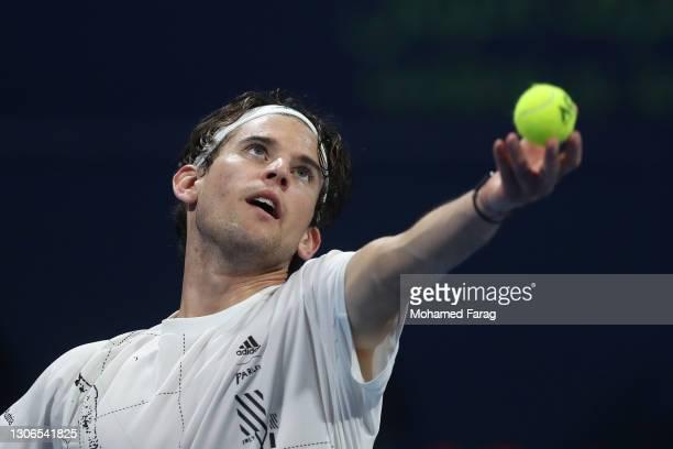 Dominic Thiem of Austria serves during his quarter final match with Roberto Bautista Agut of Spain in the Qatar ExxonMobil Open at Khalifa...