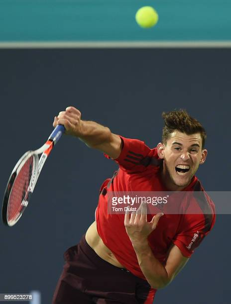 Dominic Thiem of Austria serves during his semifinal match against Kevin Anderson of South Africa on day two of the Mubadala World Tennis...