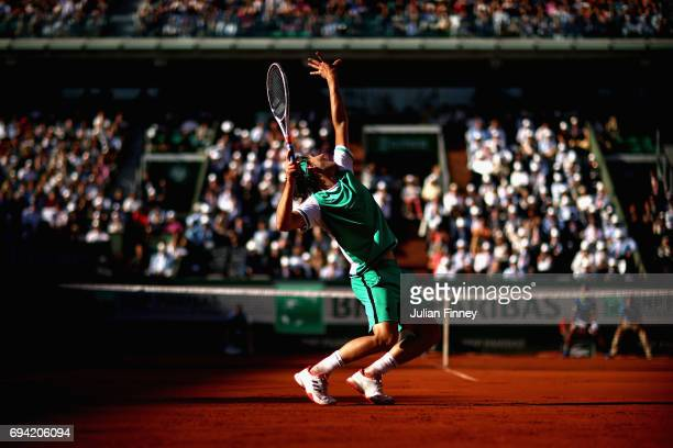 Dominic Thiem of Austria serves during mens singles semifinal match against Rafael Nadal of Spain on day thirteen of the 2017 French Open at Roland...