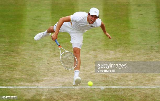 Dominic Thiem of Austria serves during the Gentlemen's Singles second round match against Gilles Simon of France on day four of the Wimbledon Lawn...