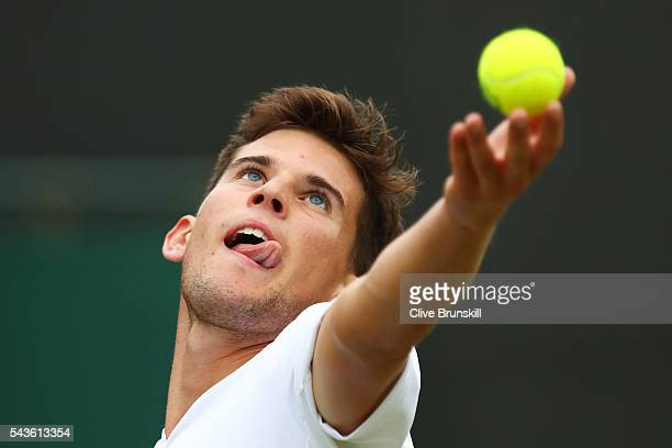 Dominic Thiem of Austria serves during the Men's Singles first round match against Florian Mayer of Germany on day three of the Wimbledon Lawn Tennis...