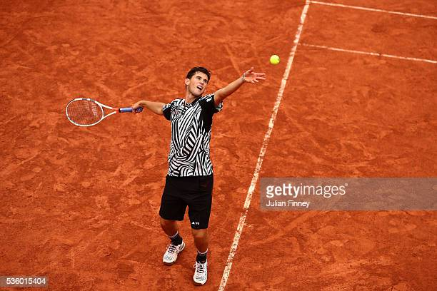 Dominic Thiem of Austria serves during the Men's Singles fourth round match against Marcel Granollers of France on day ten of the 2016 French Open at...