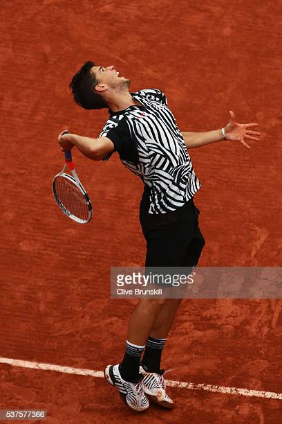 Dominic Thiem of Austria serves during the Men's Singles quarter final match against David Goffin of Belgium on day twelve of the 2016 French Open at...