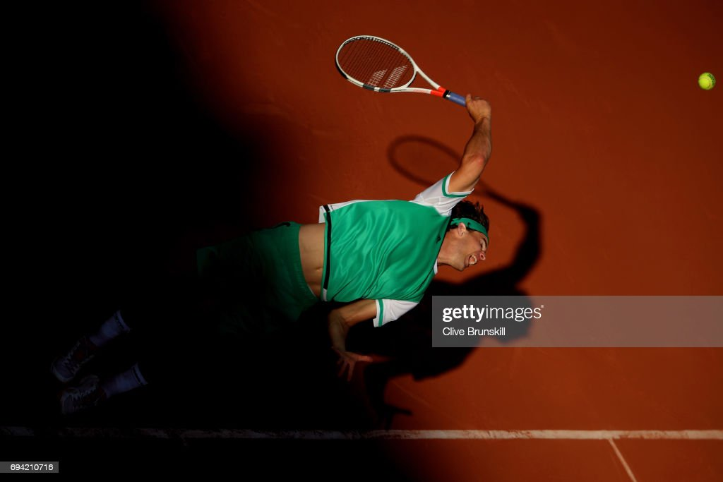 Dominic Thiem of Austria serves during the men's singles semi final match against Rafael Nadal of Spain on day thirteen of the 2017 French Open at Roland Garros on June 9, 2017 in Paris, France.