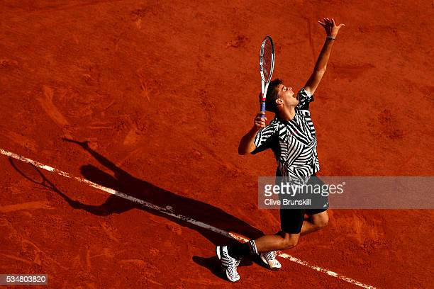 Dominic Thiem of Austria serves during the Men's Singles third round match against Alexander Zverev of Germany on day seven of the 2016 French Open...