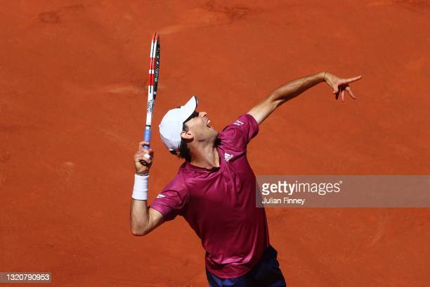 Dominic Thiem of Austria serves in his First Round match against Pablo Andujar of Spain during Day One of the 2021 French Open at Roland Garros on...
