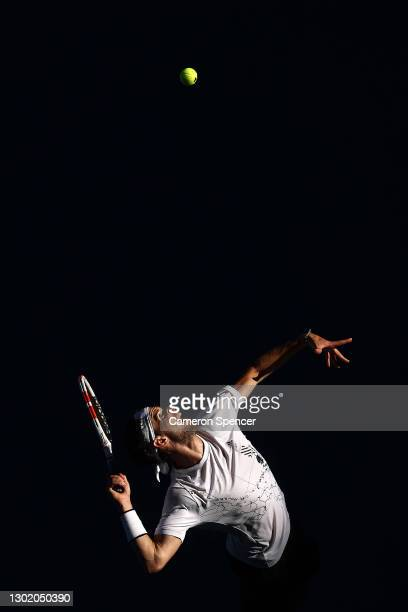 Dominic Thiem of Austria serves in his Men's Singles fourth round match against Grigor Dimitrov of Bulgaria during day seven of the 2021 Australian...
