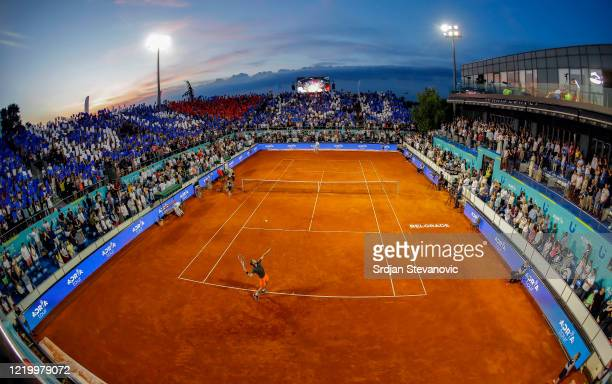Dominic Thiem of Austria serves the ball to Filip Krajinovic of Serbia during the Adria Tour charity exhibition hosted by Novak Djokovic on June 14...