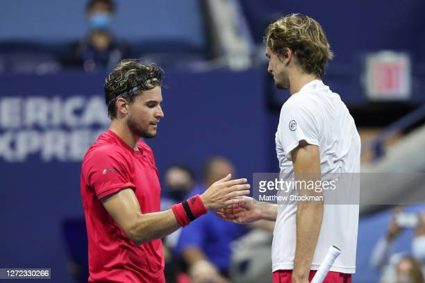 Dominic Thiem of Austria shakes hands with Alexander Zverev of Germany after winning their Men's Singles final match on Day Fourteen of the 2020 US...