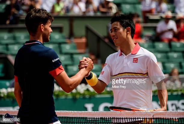 Dominic Thiem of Austria shakes hands with Kei Nishikori of Japan after winning 62 60 57 64 in the fourth round of the men's singles at Roland Garros...