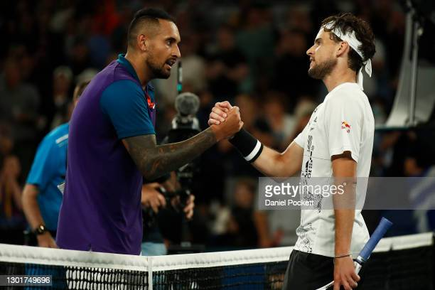 Dominic Thiem of Austria shakes hands with Nick Kyrgios of Australia after their Men's Singles third round match during day five of the 2021...