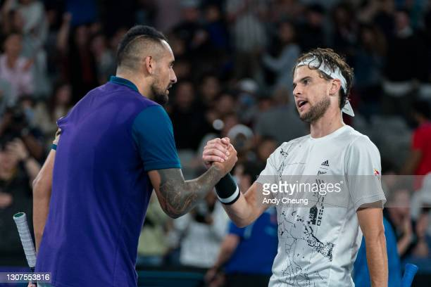 Dominic Thiem of Austria shakes hands with Nick Kyrgios of Australia in their Men's Singles third round match during day five of the 2021 Australian...