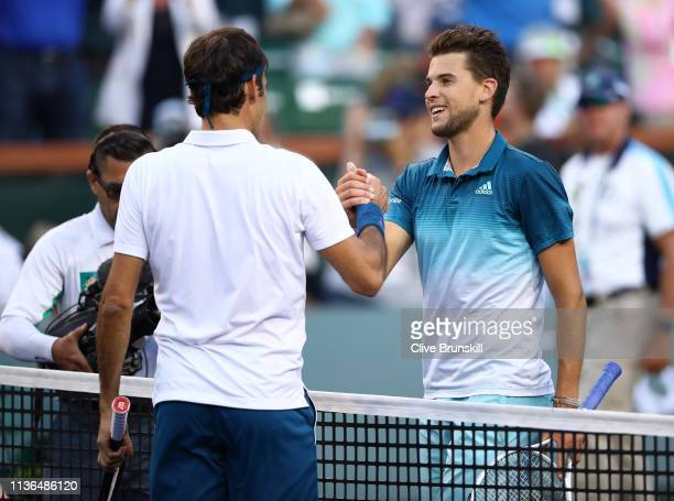 Dominic Thiem of Austria shakes hands with Roger Federer of Switzerland after his men's singles final victory on day fourteen of the BNP Paribas Open...