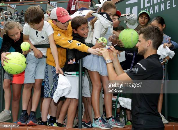 Dominic Thiem of Austria signs autographs following his match with Stefanos Tsitsipas of Greece during the BNP Paribas Open on March 10 2018 at the...