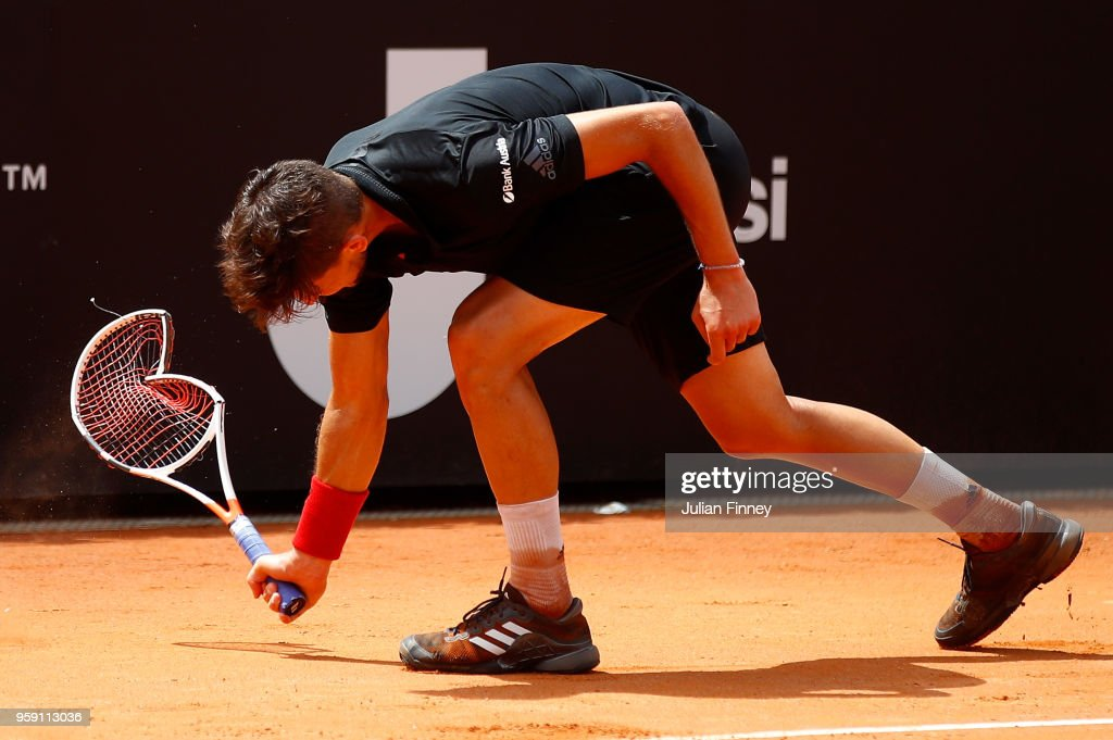 Dominic Thiem of Austria smashes his racket in frustration in his match against Fabio Fognini of Italy during day four of the Internazionali BNL d'Italia 2018 tennis at Foro Italico on May 16, 2018 in Rome, Italy.