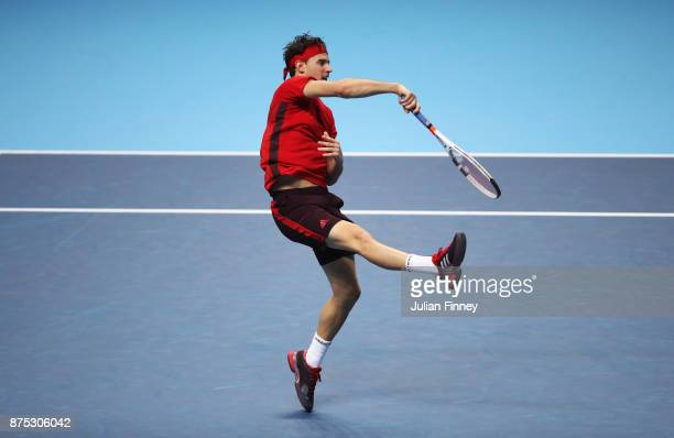 Dominic Thiem of Austria smashes in his Singles match against David Goffin of Belgium during day six of the Nitto ATP World Tour Finals at O2 Arena...