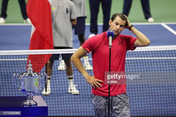 Dominic Thiem of Austria speaks before being awarded the championship trophy after winning in a tie-breaker during his Men's Singles final match...