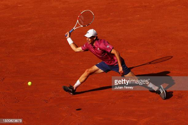 Dominic Thiem of Austria stretches to play a forehand in his First Round match against Pablo Andujar of Spain during Day One of the 2021 French Open...