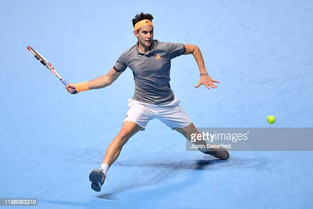 Dominic Thiem of Austria stretches to play a forehand in his semi-final singles match against Alexander Zverev of Germany during Day Seven of the...