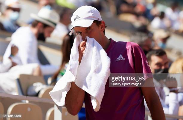 Dominic Thiem of Austria takes his towel in his First Round match against Pablo Andujar of Spain during Day One of the 2021 French Open at Roland...