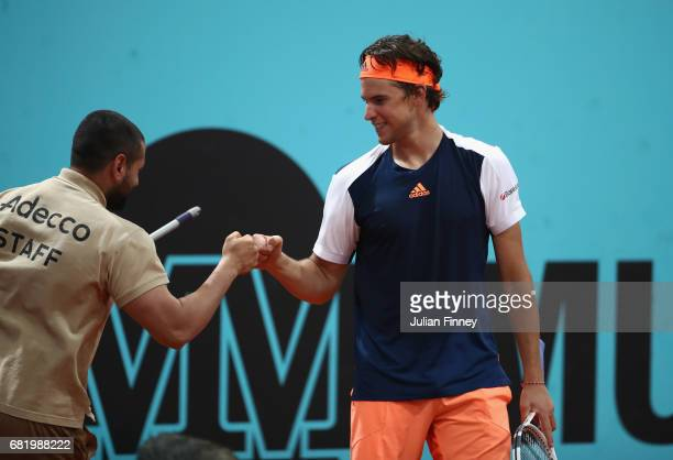 Dominic Thiem of Austria thanks the court staff after sweeping the surface in his match against Grigor Dimitrov of Bulgaria during day six of the...