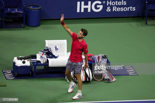 Dominic Thiem of Austria waves after winning in a tie-breaker during his Men's Singles final match against and Alexander Zverev of Germany on Day...