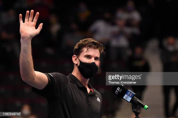 Dominic Thiem of Austria waves to fans as he is interviewed after winning his match against Vitaliy Sachko of Ukraine on day four of the Erste Bank...