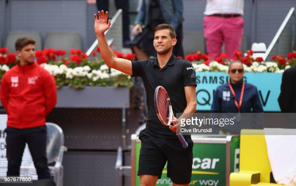 Dominic Thiem of Austria waves to the crowd after his straight set victory against Kevin Anderson of South Africa in their semi final during day...