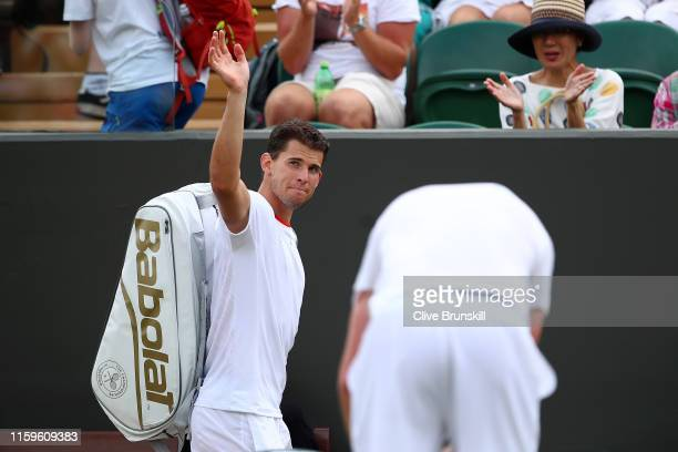 Dominic Thiem of Austria waves to the crowd as he leaves the court after loosing in his Men's Singles first round match against Sam Querrey of The...