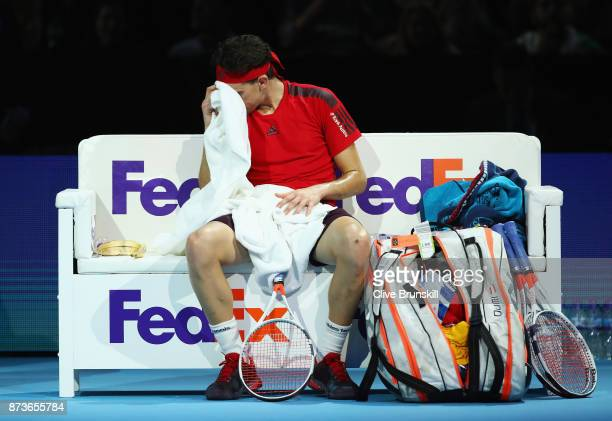 Dominic Thiem of Austria wipes his face with a towel in the Singles match against Grigor Dimitrov of Bulgaria during day two of the Nitto ATP World...