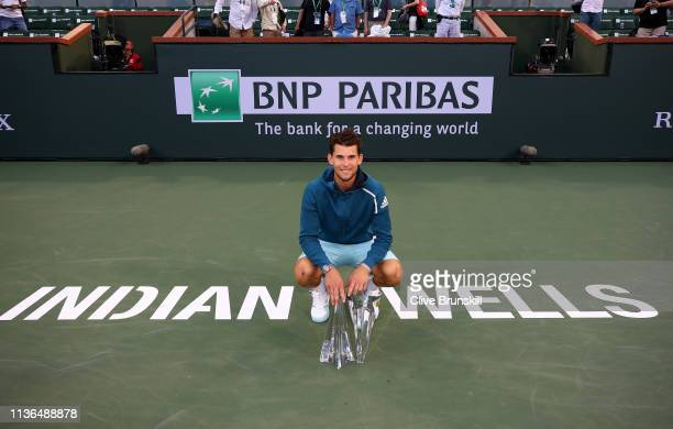 Dominic Thiem of Austria with the championship trophy after his men's singles final victory against Roger Federer of Switzerland on day fourteen of...