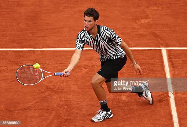 Dominic Thiem of Austriahits a forehand during the Men's Singles quarter final match against David Goffin of Belgium on day twelve of the 2016 French...
