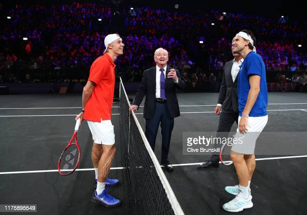 Dominic Thiem of Team Europe, Denis Shapovalov of Team World and Rod Laver take part in the coin toss prior to the start of the first match on Day...