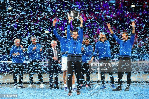 Dominic Thiem of Team Europe lifts the Laver Cup trophy following his team's victory in the final match of the tournament during Day Three of the...