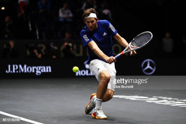 Dominic Thiem of Team Europe plays a backhand during his singles match against John Isner of Team World on the first day of the Laver Cup on...