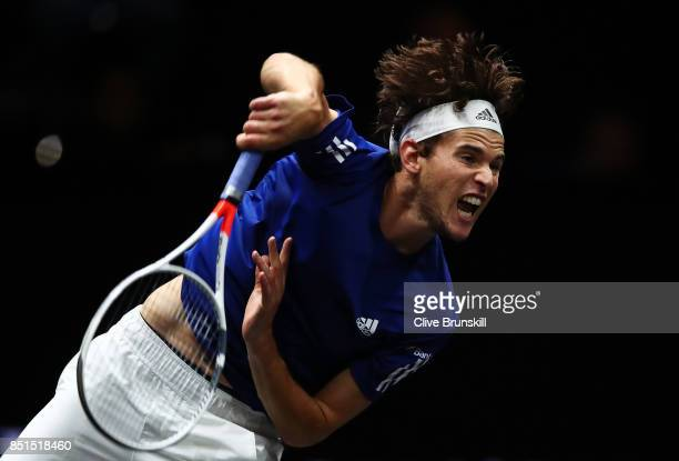 Dominic Thiem of Team Europe plays serves during his singles match against John Isner of Team World on the first day of the Laver Cup on September 22...