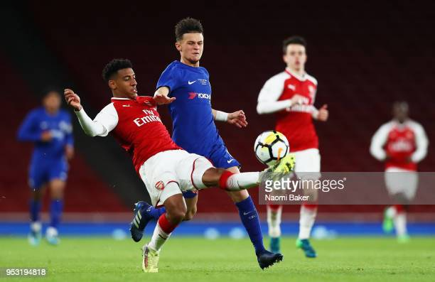 Dominic Thompson of Arsenal FC battles for posession with George Mceachran of Chelsea FC during the FA Youth Cup Final second leg match between...