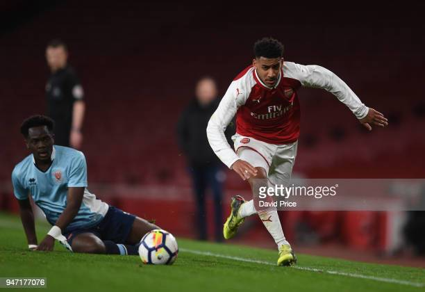 Dominic Thompson of Arsenal takes on Nana Adarkwa of Blackpool during the match between Arsenal and Blackpool at Emirates Stadium on April 16 2018 in...