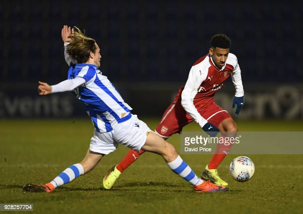 Dominic Thompson of Arsenal takes on Rob Howard of Colchester during the FA Youth Cup match between Colchester United and Arsenal at Weston Homes...