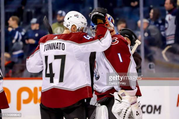 Dominic Toninato of the Colorado Avalanche congratulates goaltender Semyon Varlamov following a 41 victory over the Winnipeg Jets at the Bell MTS...