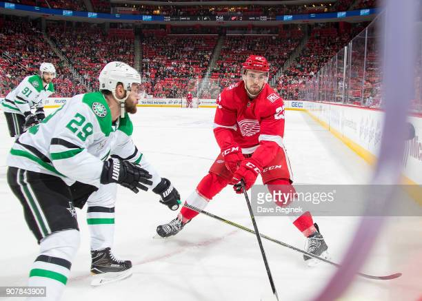 Dominic Turgeon of the Detroit Red Wings battles in the corner with Greg Pateryn of the Dallas Stars during an NHL game at Little Caesars Arena on...