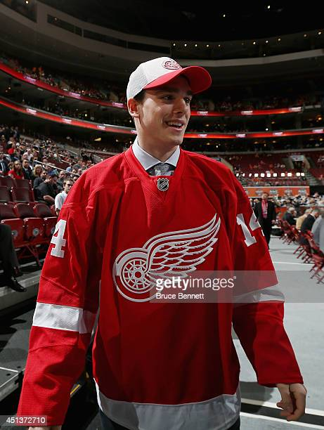 Dominic Turgeon walks to meet his team after being drafted by the Detroit Red Wings on Day Two of the 2014 NHL Draft at the Wells Fargo Center on...