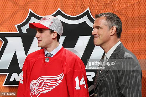 Dominic Turgeon with his father Pierre Turgeon after being drafted by the Detroit Red Wings on Day Two of the 2014 NHL Draft at the Wells Fargo...