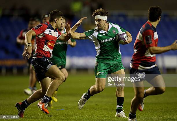 Dominic Waldouck of London Irish hands off the tackle of Julien Heriteau of Agen during the European Rugby Challenge Cup match between London Irish...