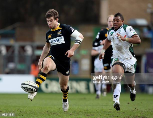 Dominic Waldouck of Wasps kicks the ball upfield to set up a try for Tom Varndell during the Guinness Premiership match between London Wasps and...
