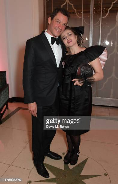 Dominic West and Helena Bonham Carter, winner Of The British Icon Award, attend the Harper's Bazaar Women of the Year Awards 2019, in partnership...