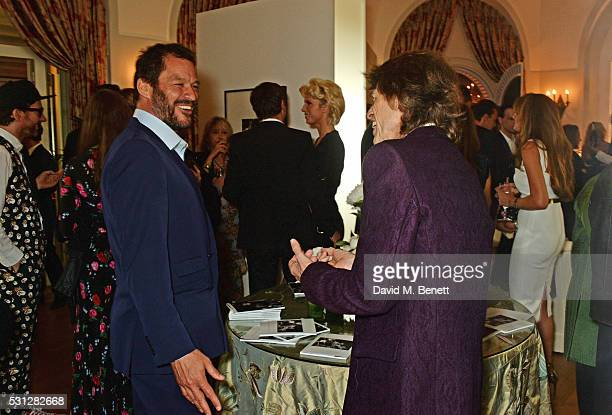 Dominic West and Sir Mick Jagger attend The 8th Annual Filmmakers Dinner hosted by Charles Finch and JaegerLeCoultre at Hotel du CapEden Roc on May...